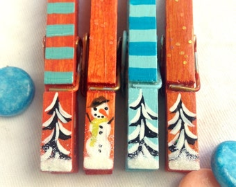 CHRISTMAS CLOTHESPINS hand painted turquoise and orange snowman snow covered trees magnet package decor hostess gift