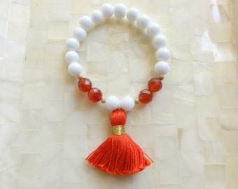 Orange Crush Smooth White Agate and Faceted Carnelian Round Bead Stretch Bracelet with Orange Cotton Tassel (B1191)