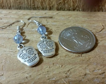 Day of the Dead, sugar skulls earrings,with a blue crystal.