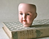 Vintage Porcelain Painted Doll Head with Blue Gray Eyes for Doll Making and Repair
