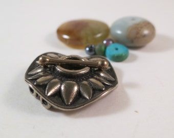 Sunflower round toggle clasp for two strands by Kim Fox in golden bronze