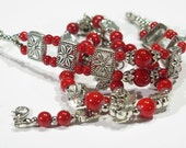 Bracelets - three with red  glass beads - silvertone findings, clasps and accents