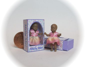 Milly Mae, dolls house miniature toy ethnic doll in a box. A dolly for your dolls house doll.