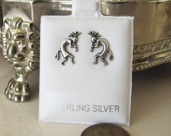 A pair of Kokopelli sterling silver stud earrings