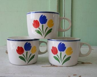 1980s TULIP TYME Mugs...set of 3. garden. coffee. tea. drink. kitsch. retro housewares. kitchen. yellow. blue. red. kitsch kitchen. designer