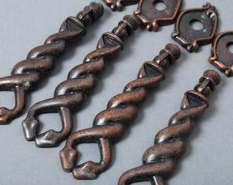 Set of 4 Vintage metal escutcheons with pull handles. Two entwined snakes