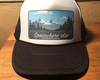 Somewhere Else Trucker Hats