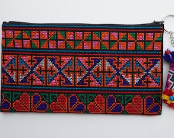 Embroidered Hmong clutch with pom pom, cosmetic bag, toiletry bag, makeup purse, travel bag, small bag, zip pouch, mini zipper pouch