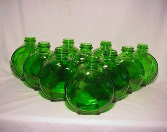 Group of Ten 1936-39 Emerald Green Glass Sunsweet Prune Juice bottles Great Wedding Decor No. 2