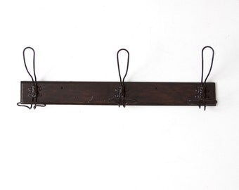 antique wall rack with wire coat hooks, mounted coat rack