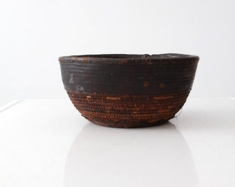 antique African bowl with leather, tribal basket