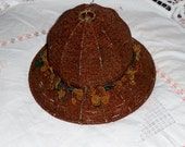 Vintage handmade beaded lamp shade with beaded flowers around it chocolate brown