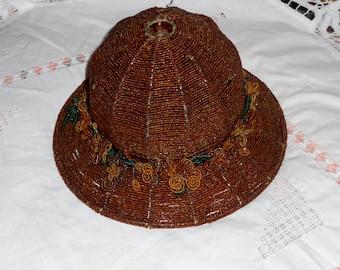 Vintage handmade beaded lamp shade with beaded flowers around it chocolate brown