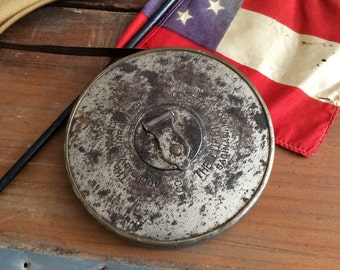 A Vintage Metal Rusty Lufkin Tape Measure Ready For A Cleaning