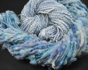 Handspun art yarn mix, merino/tencel and Bertas yarn