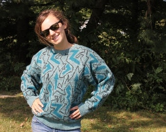 Knit Sweater with Arrows and keith herring looking designs