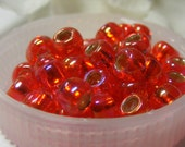 100 Siam Ruby Rainbow Silver Lined Toho Japanese Seed Beads Size 6/0 Round