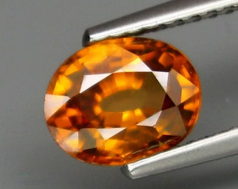 Brilliant Golden Orange Zircon Oval Faceted Cut And Shy Of 8 x 6 MM, 1.85 Carat. Natural And Genuine, Tanzania