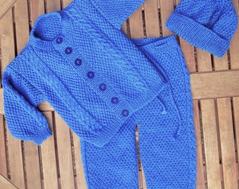 Baby infant boy toddler hand knitted blue traditional matinee outfit of jacket / cardigan trousers / legging / pants, pom pom hat pram set.