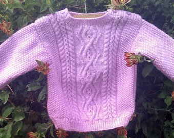 Child's girls toddlers boys handknit mauve / light purple aran cable sweater / jumper with shoulder openings.