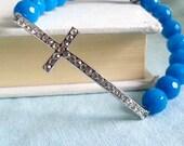 Sideways Cross Bracelet. Silver Rhinestone Cross. Stretchy Bracelet. Blue Bracelet. Cerulean Blue. Cyan Blue