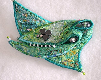 Textile brooch in green