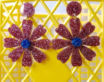 Pink and blue glitter daisy earrings.