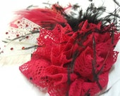 Fascinator in Black and red with feathers and filigree details