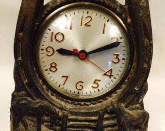 Metal Vintage Cowpoke Clock Has a Big Horseshoe and a Mini Herd of Horses