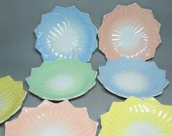 set of 7 milk glass plates Anchor Hocking Lotus pattern . 2 yellow , 2 blue , 1 green and 2 pink milk glass platonite