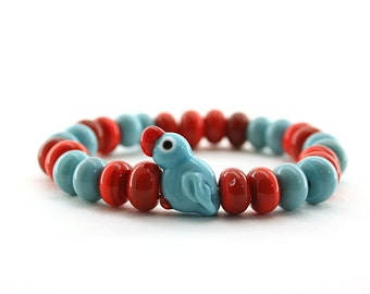 Blue and red parrot  Lampwork  glass bracelet /  figurine/ sculpture/ miniature glass / set of 28 spacer lampwork beads and one parrot bead