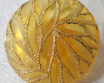 """Vintage glass button 0.75"""" ins across, orange peach toned with 'gold' branch like design on top. Shank back, lovely button. CLAM15.3-4.9-43."""