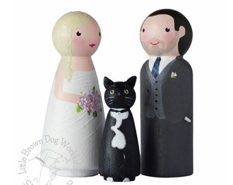Bride and Groom and pet cat wedding decoration. Custom hand painted wooden peg doll cake topper