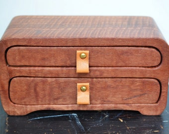 Large wooden box. Fiddleback figured Karri timber. Twin drawer. Leather and brass drawer pulls.