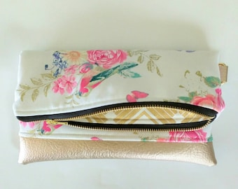 Small clutch in white floral with metallic gold interior