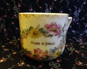 """Vintage Mug 1930s/40s - White porcelain - """"from a friend"""" in gold framed by a ring of colorful flowers & leaves, """"Germany"""", transfer pattern"""