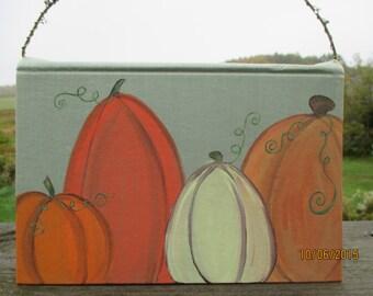 Hand painted pumpkins, upcycled vintage book, book art, pumpkin art, fall art, halloween pumpkins, Thanksgiving art , recycled library book