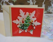 Vintage Christmas Card unused Raised snowflake Retro Man Woman decorating tree dimensional red