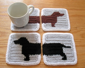 Dachshund Dog Coasters. Crochet coaster set with black and brown dachshund silhouettes. Wiener dog decor