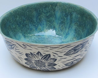 ceramics and pottery serving bowl; hand carved pottery