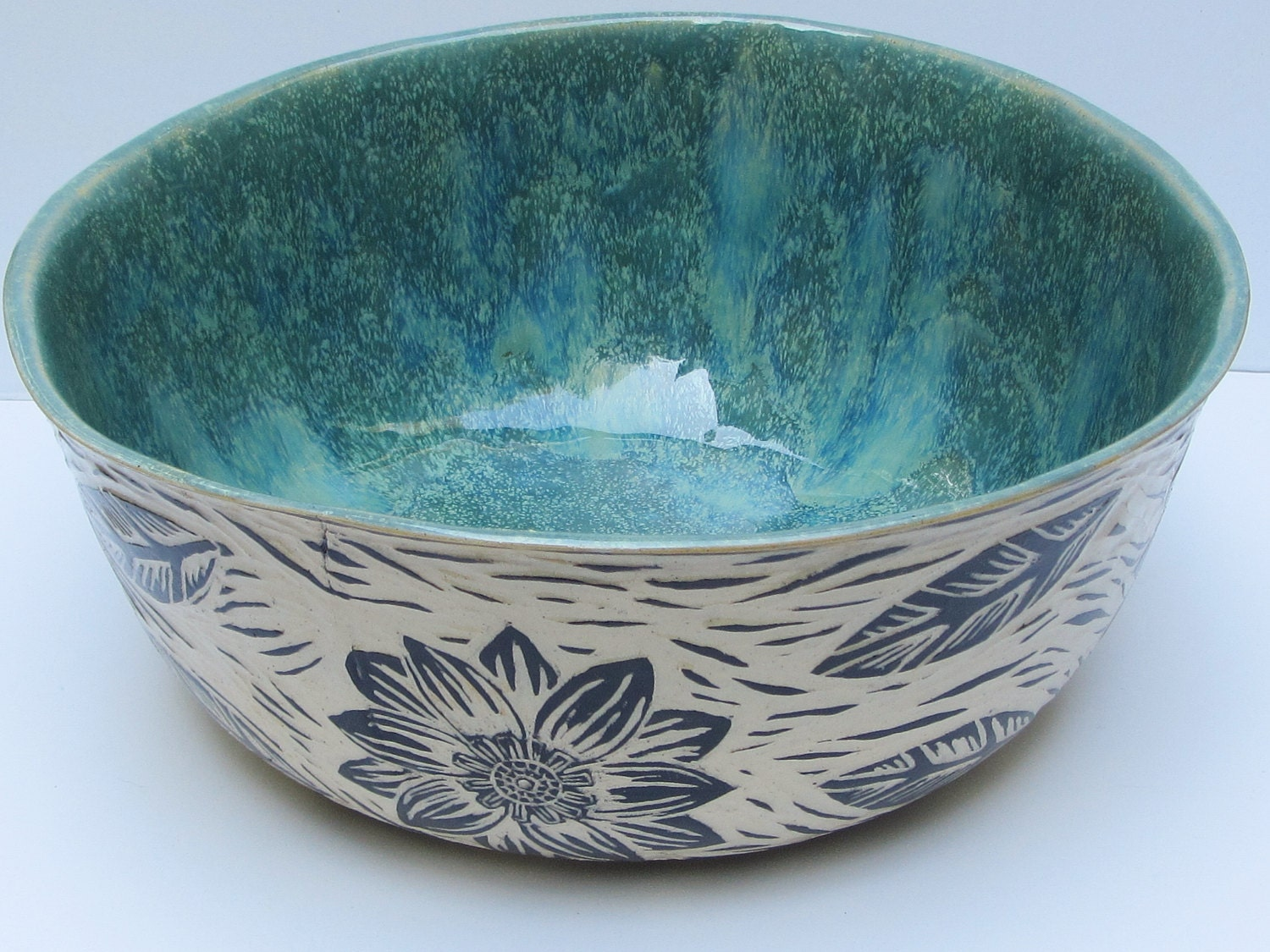 Ceramics and pottery serving bowl hand carved