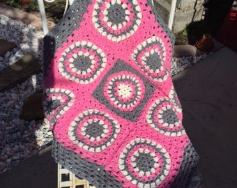Beautiful crocheted baby blanket in pink grey and white