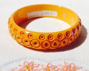 Bakelite Bangle Yellow Carved Circles
