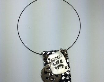 Handcrafted layered metal message pendant