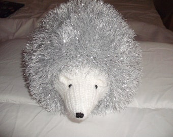 beautiful hand made tinsel hedgehog in silver with white face