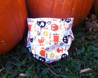 One Size Pocket Cloth Diaper with insert made from PUL Halloween ooga booga monster fabric for 8 lbs to 30 lbs - in stock