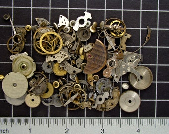 Mixed Vintage Watch Parts, Gears, Wheels, Balance Cocks, Plates, Hands, Crowns & Mainspring Barrels in Steel and Brass Art Supplies 04357