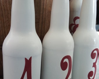 Bottle table markers or vases