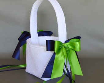 White lace wedding flower girl basket with navy blue and green ribbons