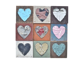 9 primitive hearts mixed media assemblage  by Elizabeth Rosen